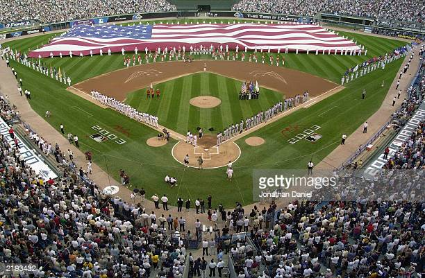 The American Flag covers the outfield prior to the 74th Major League Baseball AllStar Game between the American League AllStars and the National...