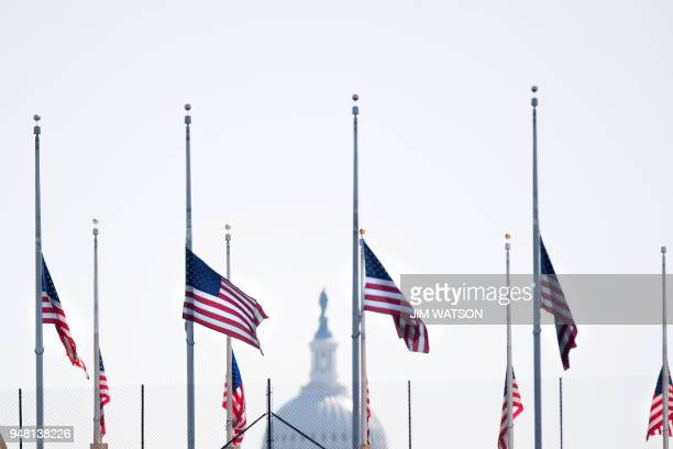 The American flag flies at half mast in Washington DC on April 18 in honor of former First Lady Barbara Bush who passed away Tuesday night Former US...