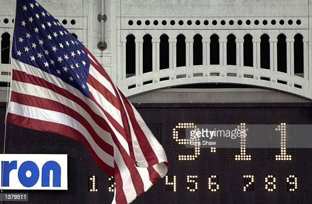 The American Flag flies at half staff near the scoreboard during the moment of silence at 911 pm as the New York Yankees played the Baltimore Orioles...