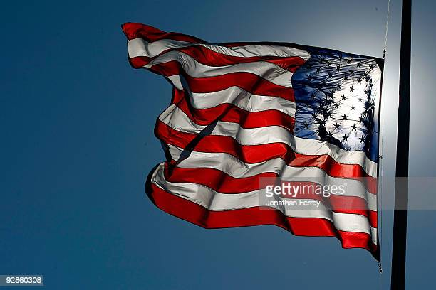 The American Flag flies at halfmast during practice for the NASCAR Nationwide Series O'Reilly Challenge at Texas Motor Speedway on November 6 2009 in...