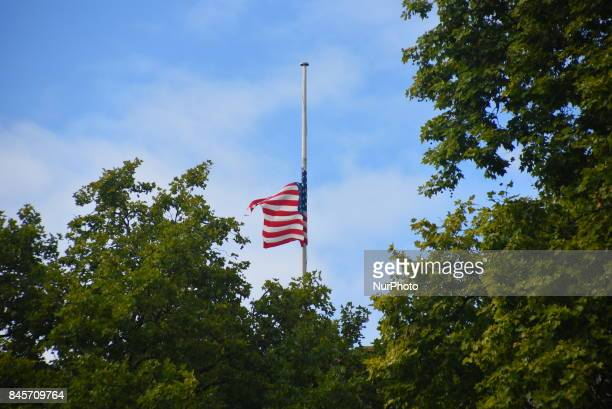 The American flag flies at halfmast to commemorate the victims of 9/11 terror attack London on September 11 2017 The September 11 attacks were a...
