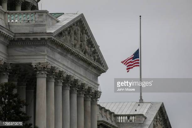 The American flag flies at half-staff at the U.S. Capitol on January 08, 2021 in Washington, DC. House Speaker Nancy Pelosi ordered the building's...