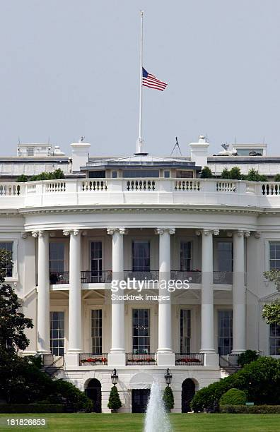 The American Flag flies at half-staff atop the White House in Washington D.C.