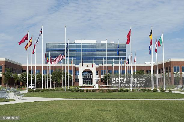 The American flag flies at halfstaff outside the NATO headquarters building at Camp Allen in remembrance of the five service members killed in a...