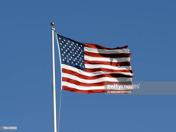 The American Flag flies in a stiff breeze during pregame ceremonies as the Tampa Bay Buccaneers host the Atlanta Falcons at the Raymond James Stadium...