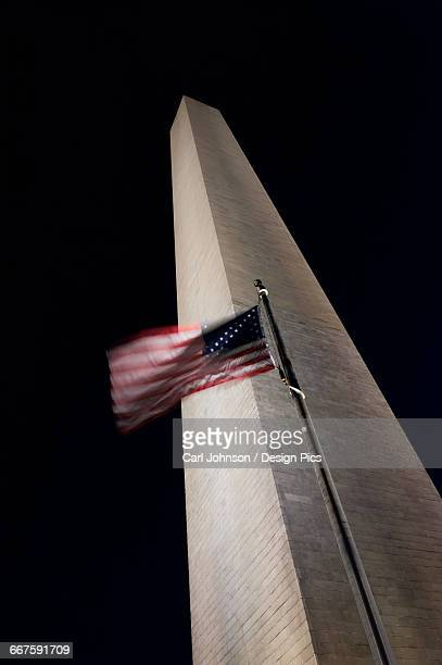The American flag flies in a stiff wind at the Washington Monument
