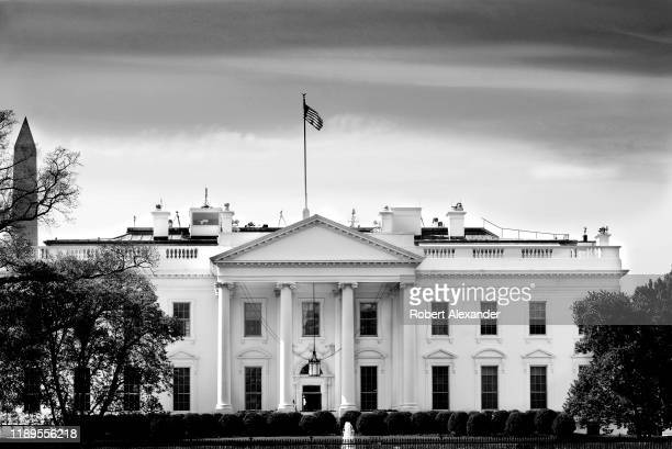 The American flag flies over the North Portico of the White House in Washington DC