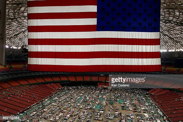 The American flag hangs above the crowd of 16000 displaced New Orleans citizens as a result of Hurricane Katrina during their temporary housing at...