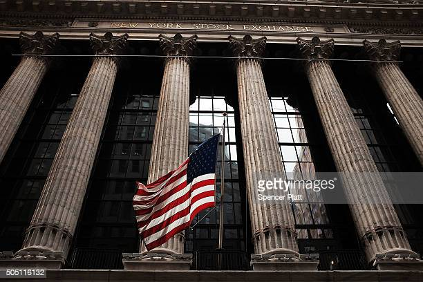 The American Flag hangs down from the New York Stock Exchange on January 15 2016 in New York City Stocks have fallen significantly in morning trading...