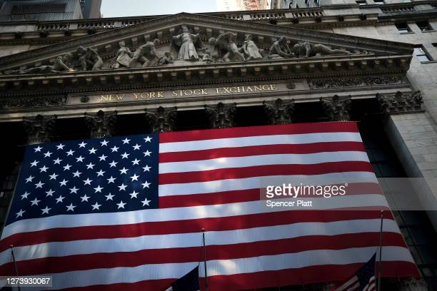 The American Flag hangs from in front of the New York Stock Exchange in lower Manhattan on September 21, 2020 in New York City. As parts of Europe...