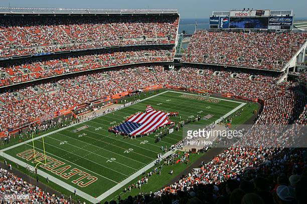 The American flag is brought onto the field during the singing of the National Anthem prior to the game between the Cincinnati Bengals and the...