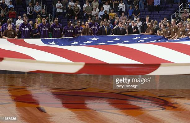 The American flag is dislayed during the National Anthem before the NBA preseason game between the Golden State Warriors and the Phoenix Suns at...