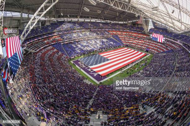 The American Flag is displayed during the game between between the Minnesota Vikings and the New Orleans Saints on September 11 2017 at the US Bank...