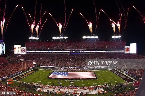 The American Flag is displayed on the field during the National Anthem prior to the start of the National Championship game between the Alabama...