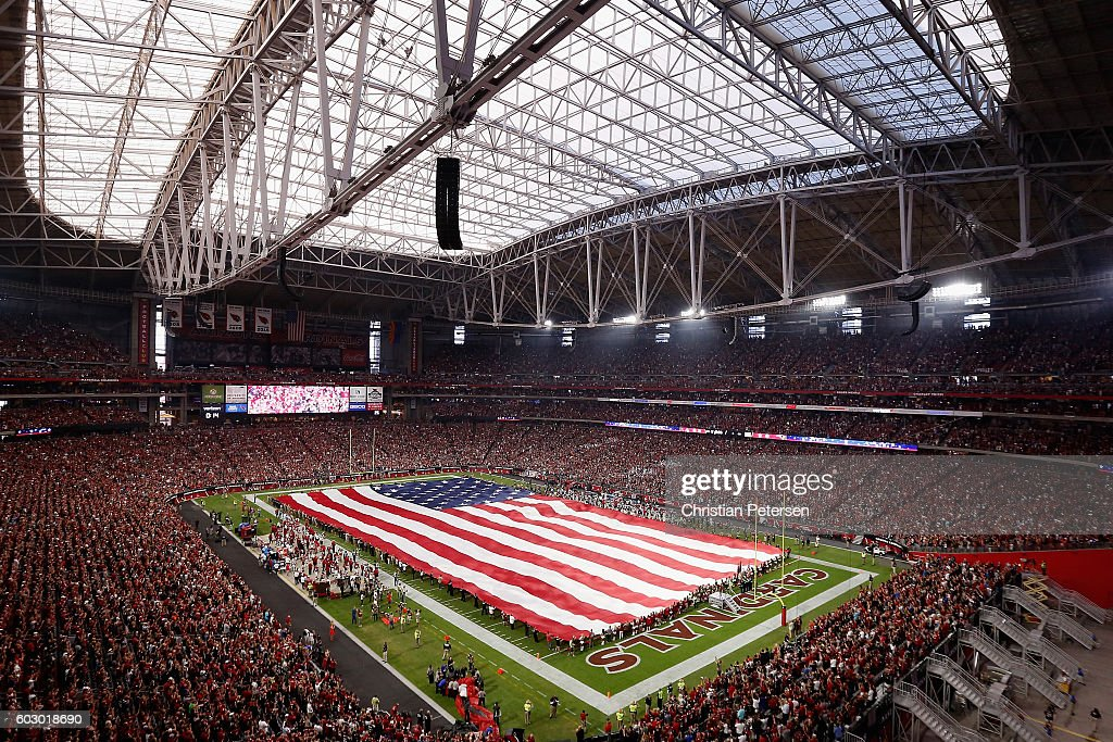 The american flag is draped across the field for the national anthem to the NFL game between the Arizona Cardinals and the New England Patriots at the University of Phoenix Stadium on September 11, 2016 in Glendale, Arizona.