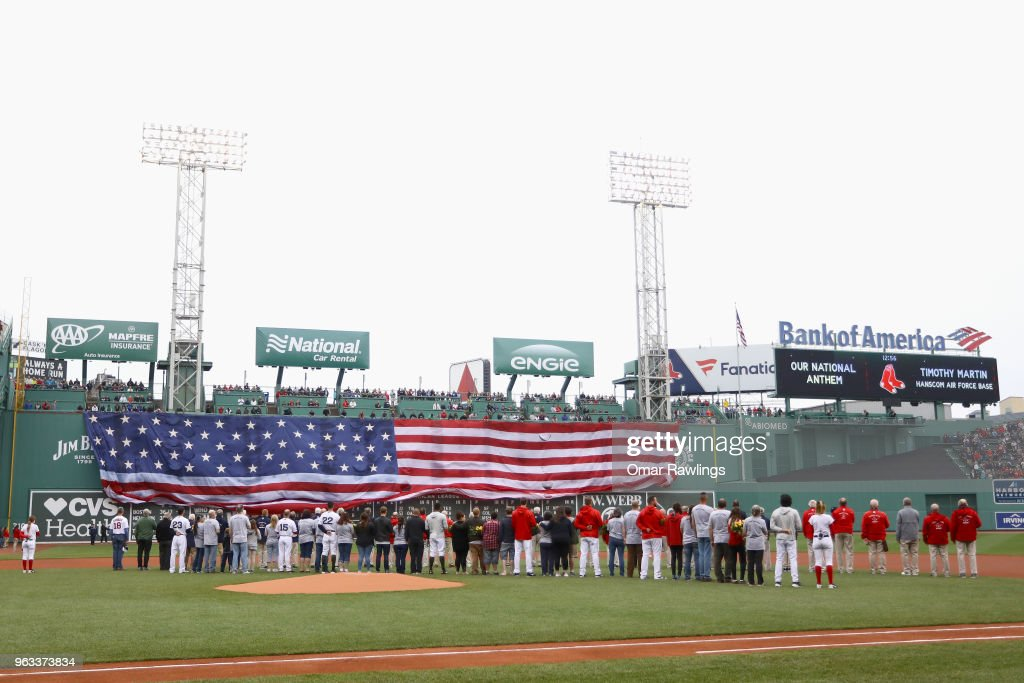 The American Flag is draped from the Green Monster as Gold Star families and Veterans from the Red Sox organization look on before the game between the Boston Red Sox and the Toronto Blue Jays at Fenway Park on May 28, 2018 in Boston, Massachusetts. MLB Players across the league are wearing special uniforms to commemorate Memorial Day.