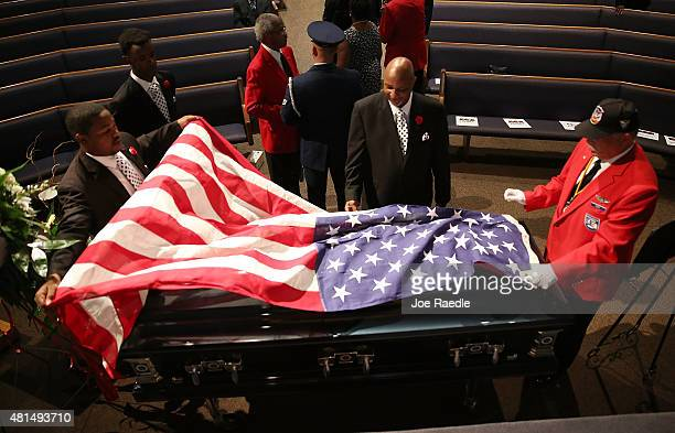 The American flag is drapped over the casket of retired Air Force Lt Col Eldridge Williams during his funeral at the Sweet Home Missionary Baptist...