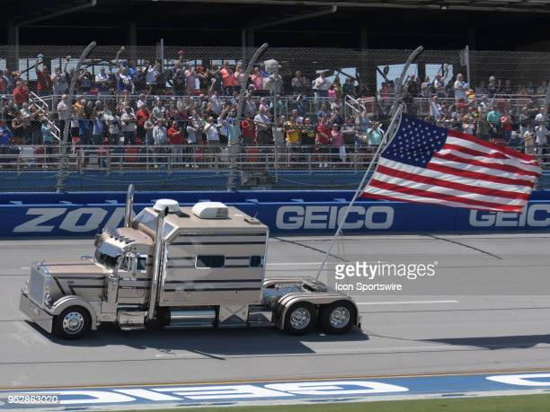 The American Flag is driven through the trioval before the Monster Energy Cup Series 49th Annual Geico 500 on April 29 at Talladega Superspeedway in...