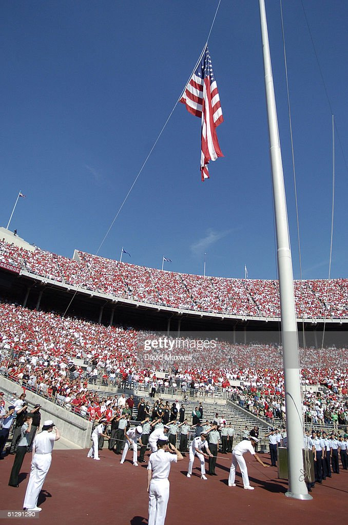 The American flag is lowered to half mast during a September 11 memorial before the game between the Ohio State Buckeyes and the Marshall Thundering Herd on September 11, 2004 at Ohio Stadium in Columbus, Ohio.