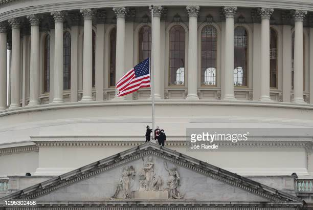 The American flag is lowered to half-staff atop the U.S. Capitol Building following the death of a U.S. Capitol Police Officer on January 08, 2021 in...