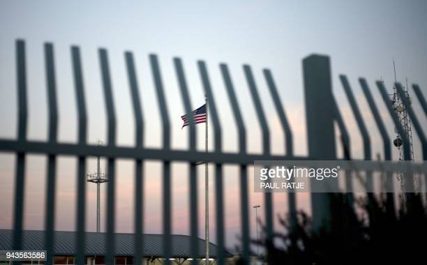 The American flag is pictured outside the the Paso del Norte Port of Entry in El Paso Texas Saturday April 7 2018 The US states of Texas and Arizona...