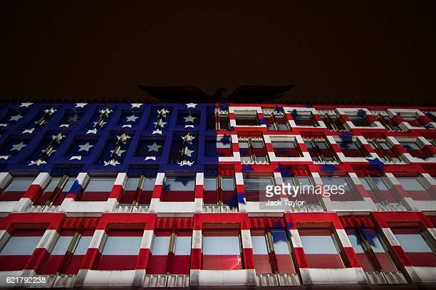 The American flag is projected on to the United States Embassy during an election night party on November 8 2016 in London England Americans have...
