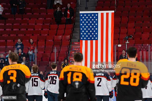 The American flag is raised after Team United States defeated Team Germany during the 2015 IIHF World Junior Hockey Championship game at the Bell...