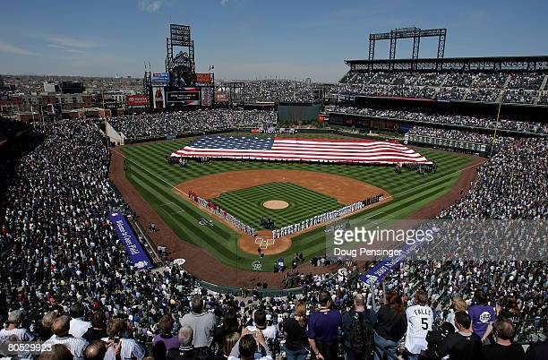 The American Flag is unfurled across the field by military service men and woman as the national anthem is played as the Arizona Diamondbacks face...