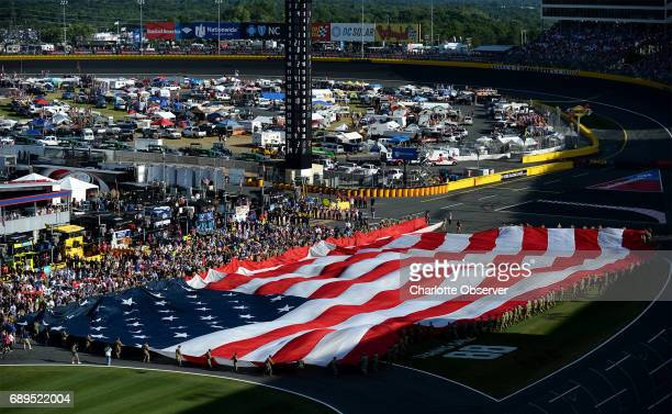 The American flag is unfurled during the national anthem during prerace activities for the CocaCola 600 at Charlotte Motor Speedway on Sunday May 28...