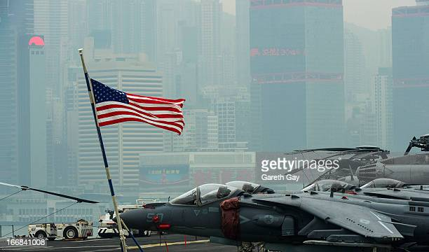 The American flag raised aboard the USS Peleliu during its mooring at Tsim Sha Tsui on April 16 2013 in Hong Kong The amphibious assault ship was...