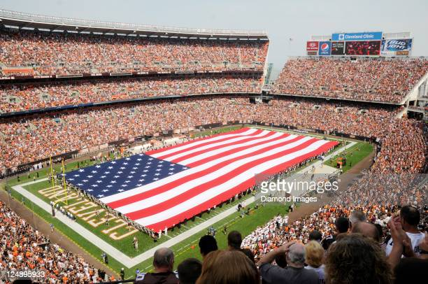 The American Flag spread over the field as part of a ceremony honoring and remembering the victims of the attacks on America on 9/11/2001 prior to a...