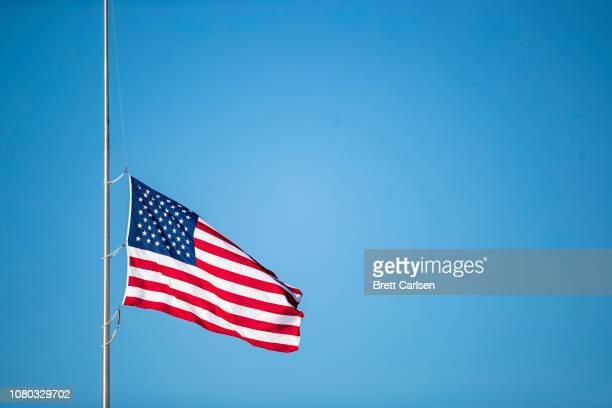 The American flag waives at half mast in memory of late U.S. President George H. W. Bush before the game between the Buffalo Bills and the New York...