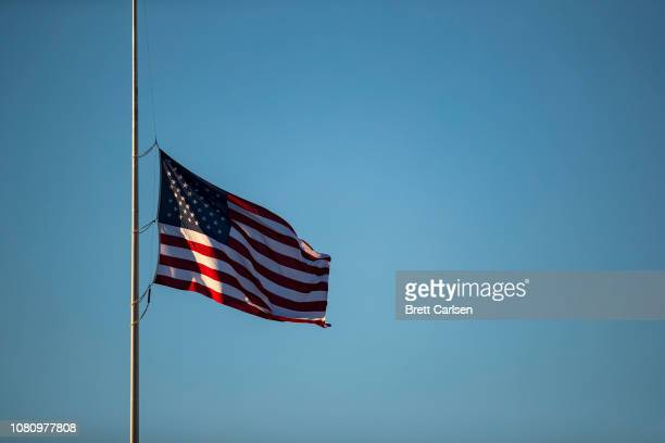 The American flag waives at half mast in memory of late U.S. President George H. W. Bush during the game between the Buffalo Bills and the New York...