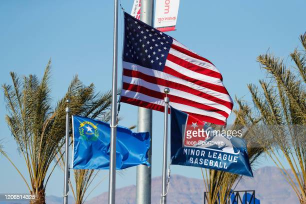 The American flag waves in the breeze along with the Nevada state flag and a Minor League Baseball flag during Big League Weekend featuring the...