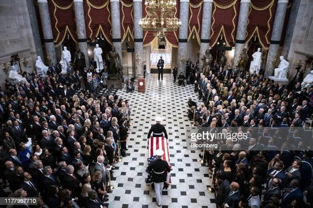 The American flagdraped casket of late Maryland Representative Elijah Cummings is carried through National Statuary Hall during a memorial service at...