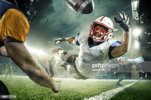 the american football players in the action - quarterback stock photos and pictures