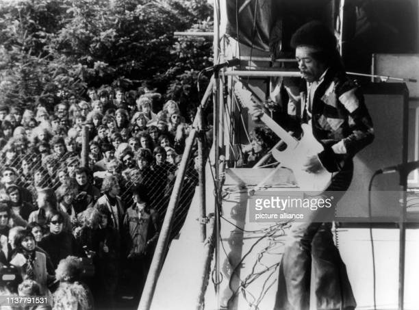 """The american guitarist Jimi Hendrix performs at the """"Love and Peace"""" music festival on the baltic island of Fehmarn on 6. September 1970. 
