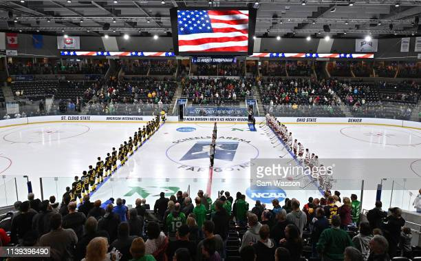 The American International Yellow Jackets and the Denver Pioneers line up for the singing of the American national anthem before the NCAA Division I...