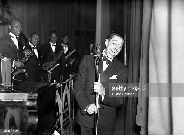 The American jazz musician and bandleader Cab Calloway performing with his orchestra at the Elephant and Castle Trocadero in London