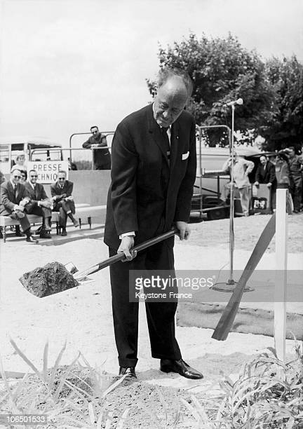 The American Magnate Of International Hotel Business Conrad Hilton Digging The Location Of The First Stone Of The Palace Made Of 260 Rooms In Orly On...