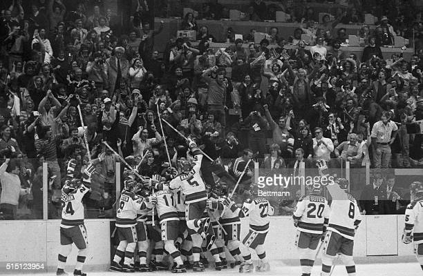 The American Olympic hockey team members whoop it up along with the crowd of spectators after they upset the Soviet Union with 43 in the semifinal...