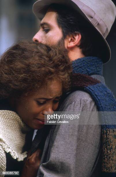 The American opera singer Barbara Hendricks and Canadian opera singer Gino Quilico embrace during the shooting of the musical La Boheme based on...