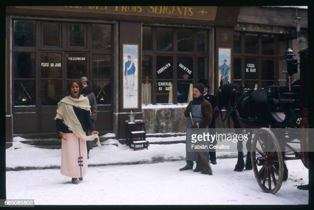 The American opera singer Barbara Hendricks sings in front of a cafe surrounded by a street cleaner a carriage driver and Canadian opera singer Gino...