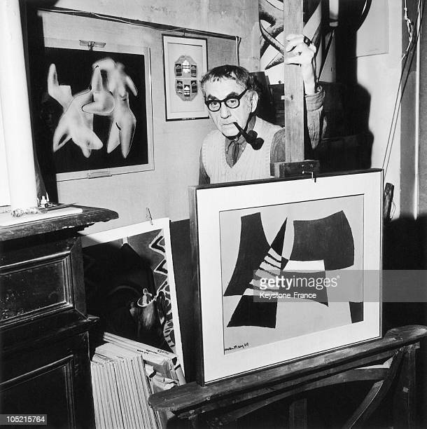 The American Painter And Photographer Man Ray Posing With Some Of His Works In His Flat In Paris On April 20 1970
