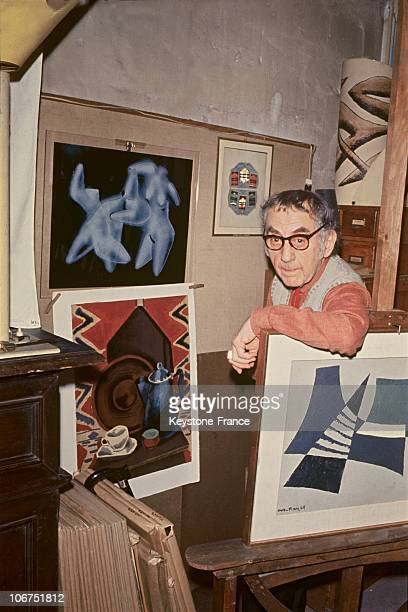 The American Painter-Photographer Man Ray, Aged 80, Among His Surrealist Paintings In His Paris Apartment On April 20, 1970. One Of His Solarized...