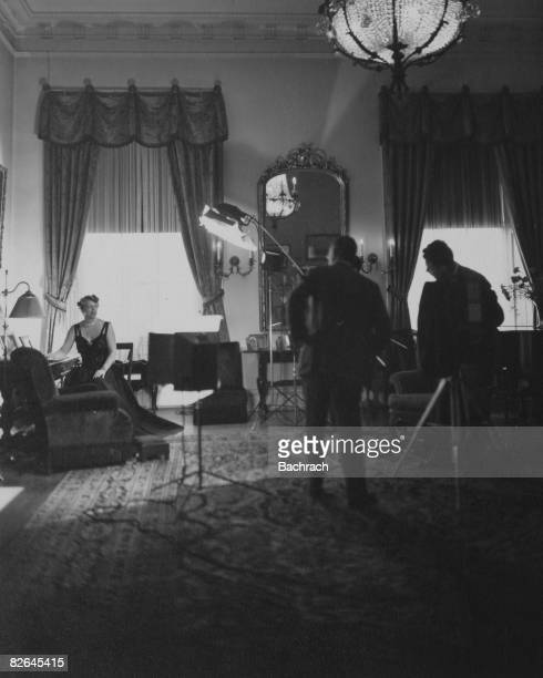 The American photographer Louis Fabian Bachrach prepares for a portrait session with American First Lady Eleanor Roosevelt in a room at the White...