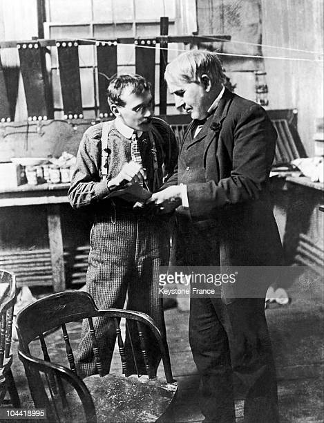The American Physicist Thomas Edison Inventor Of The Incandescent Lightbulb Among Other Things In An Acculumaters Laboratory With An Assistant In 1906