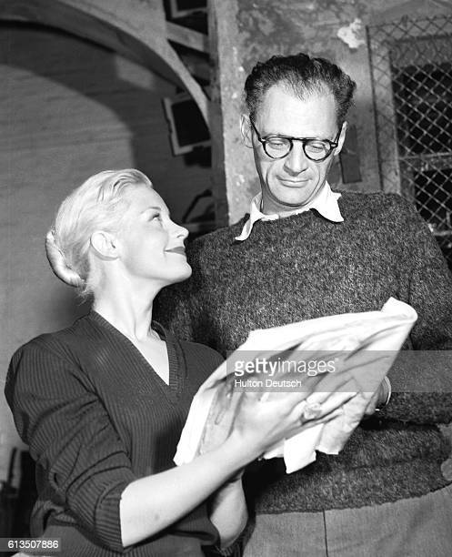 The American playwright Arthur Miller with the actress Mary Ure, at the rehearsals for his play A View from the Bridge at the Comedy Theatre, 1956.