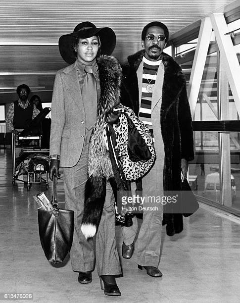 The American pop singer Tina Turner arrives at London Airport with her husband, the singer and songwriter Ike Turner. They performed together as a...