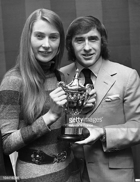 The American racecar driver Jackie STEWART offering Nina RINDT wife of the Austrian racecar driver Jochen RINDT the trophy awarded posthumously of...